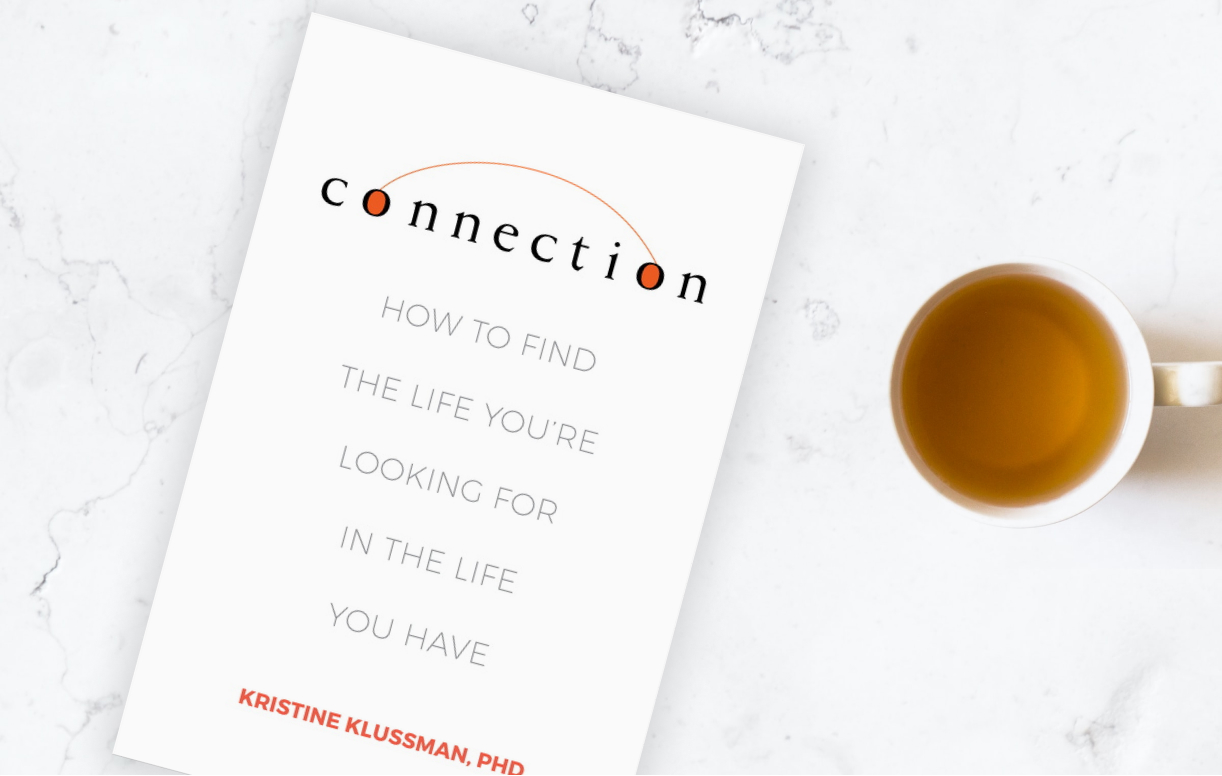 Kristine Klussman book cover and a cup of tea